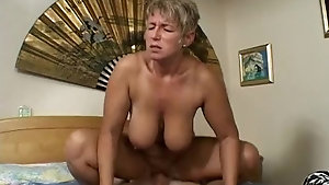 Mature skank loves young dude's dick but hates his cum