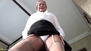 Kinky mature granny April teases and toys herself in bed