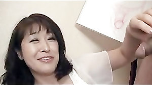 Hairy Japanese milf Agaki Oda swallows and rides a cock