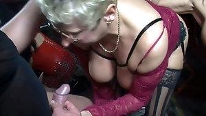 Pushing dildo into cock hole